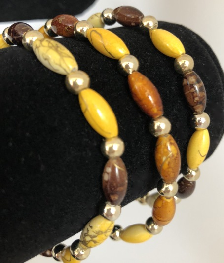 Armband brunt / beige / gult