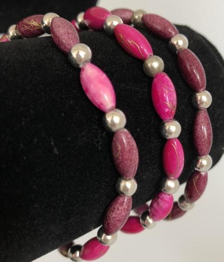 Armband i rosa och lila
