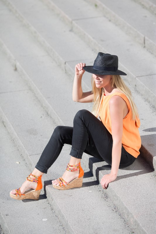 Orange wedges with a matching outfit.