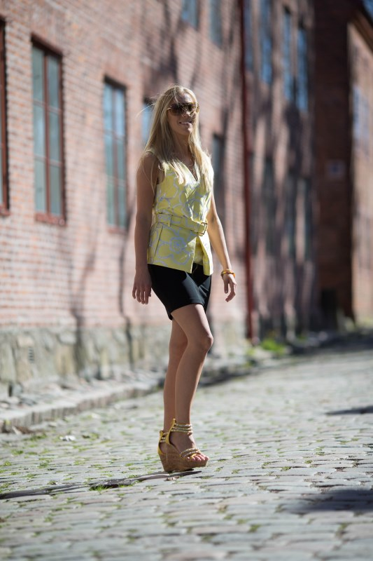 Woman wearing yellow Tess from Caribbyshoes